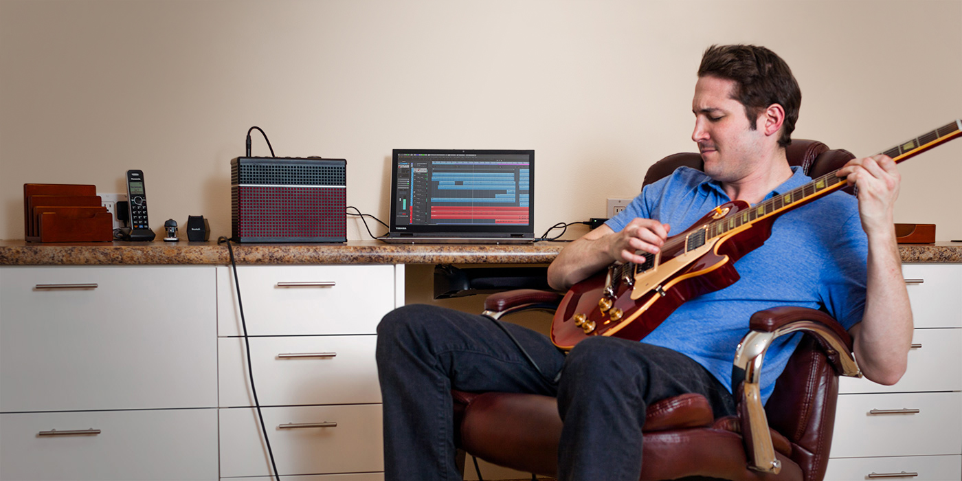 Guitarist recording via USB with a Line 6 AMPLIFi 30 guitar amp with amp and effects models