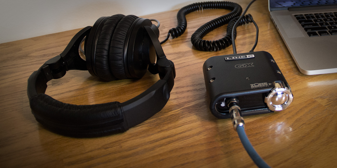 Line 6 POD Studio GX recording interface plugged into a laptop and headphones